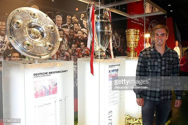 Philipp Lahm team captain of FC Bayern Muenchen opens the Bayern Muenchen Triple 2013 Exhibition with the UEFA Champions League winners trophy German...