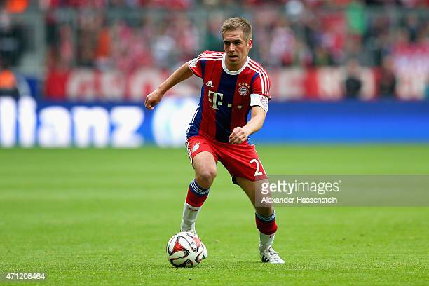 Philipp Lahm, team captain of Muenchen runs with the ball during the Bundesliga match between FC Bayern Muenchen and Hertha BSC Berlin at Allianz...