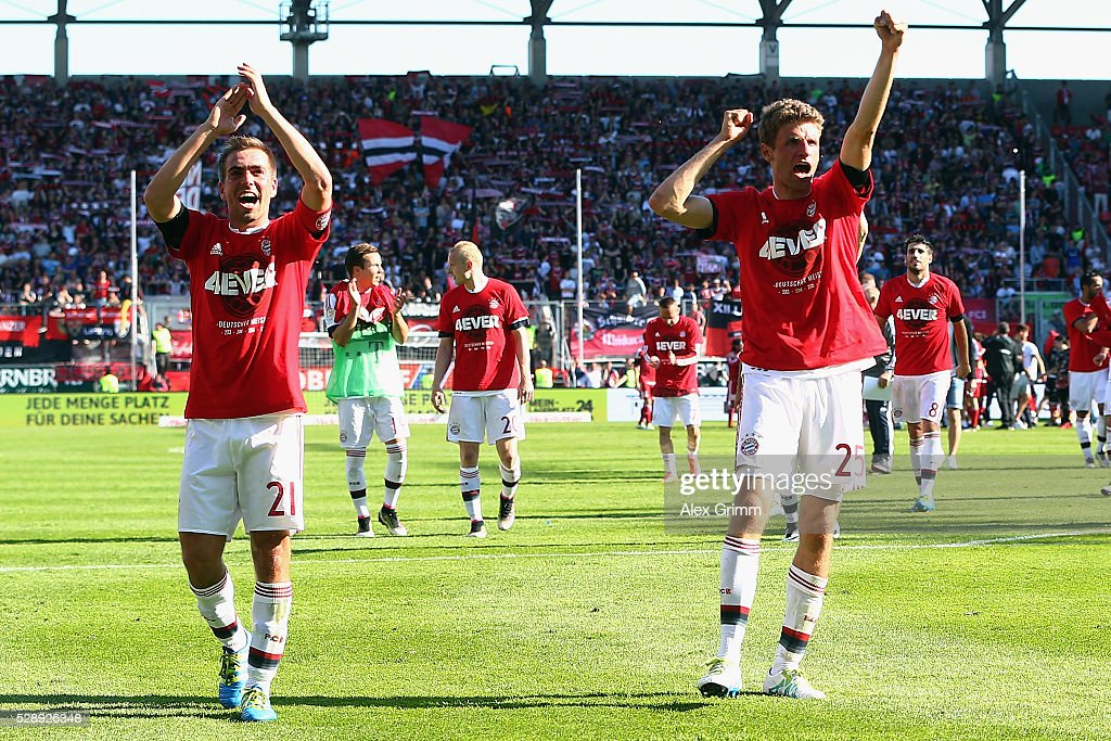 Philipp Lahm (L), Thomas Mueller and team mates of Muenchen celebrate being Bundesliga champions after beating Ingolstadt 2-1 in Rafinha (front) and team mates of Muenchen celebrate their team's fourth consequtive German Championship after the Bundesliga match between FC Imgolstadt and FC Bayern Muenchen at Audi Sportpark on May 07, 2016 in Ingolstadt, Bavaria.