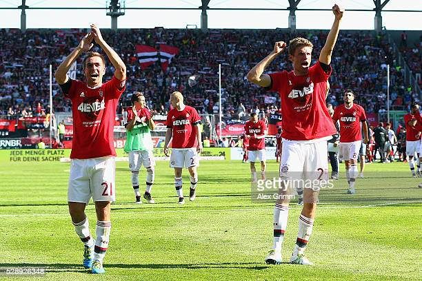 Philipp Lahm Thomas Mueller and team mates of Muenchen celebrate being Bundesliga champions after beating Ingolstadt 21 in Rafinha and team mates of...
