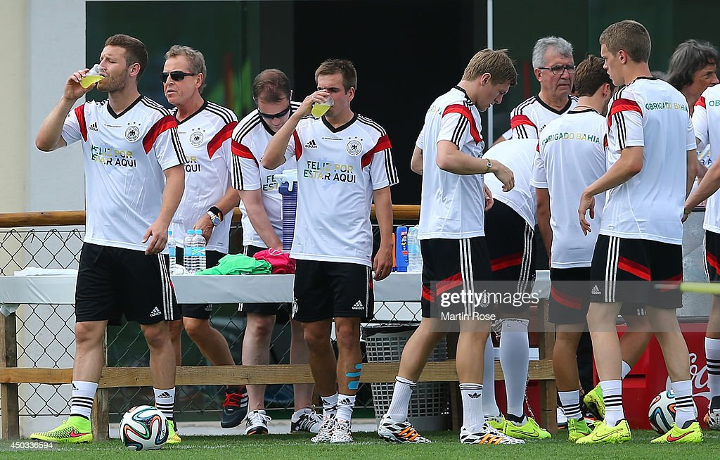 Philipp Lahm (C) tkes a drink during the German National team training session at Campo Bahia on June 9, 2014 in Santo Andre, Brazil.