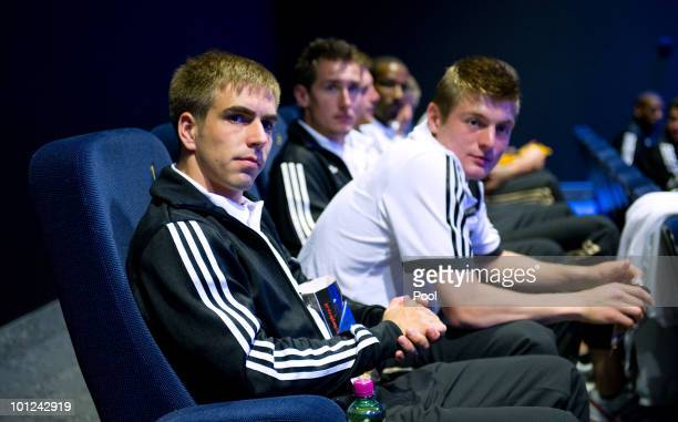 """Philipp Lahm, Toni Kroos, Miroslav Klose of team Germany wait for watching the movie """"Invictus"""" in the Cineplexx cinema in Bolzano during the 2010..."""