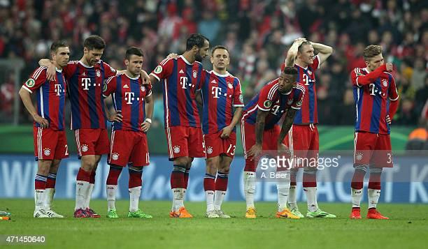 Philipp Lahm Xabi Alonso Juan Bernat Medhi Benatia Rafinha Jerome Boateng Bastian Schweinsteiger and Mitchell Weiser of Bayern Muenchen react after a...