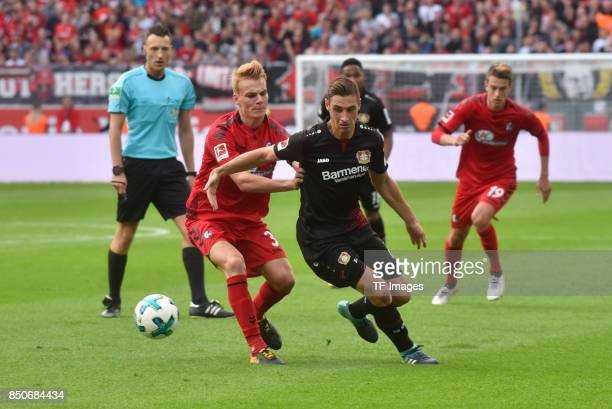Philipp Lienhart and Dominik Kohr of Leverkusenbattle for the ball during the Bundesliga match between Bayer 04 Leverkusen and SC Freiburg at...
