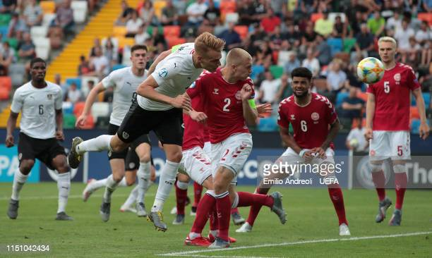Philipp Lienhart of Austria scores his goal during the 2019 UEFA U21 Group B match between Denmark and Austria at Stadio Friuli on June 20 2019 in...