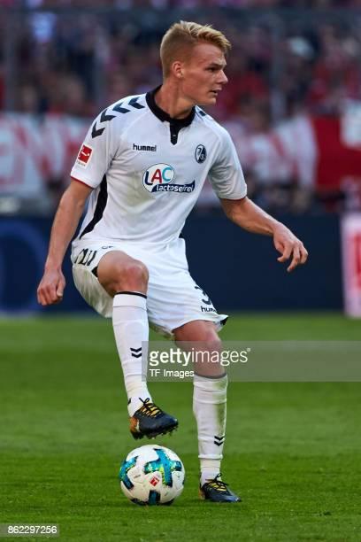 Philipp Lienhart of Freiburg controls the ball during the Bundesliga soccer match between FC Bayern Munich and SC Freiburg at Allianz Arena in Munich...