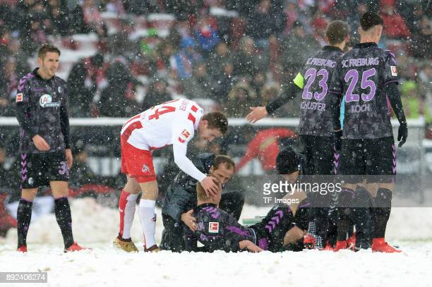 Philipp Lienhart of Freiburg lays injured on the ground during the Bundesliga match between 1 FC Koeln and SportClub Freiburg at RheinEnergieStadion...
