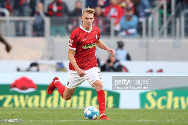 Philipp Lienhart of Freiburg runs with the ball during the Bundesliga match between Sport-Club Freiburg and RB Leipzig at SC-Stadion on October 16,...