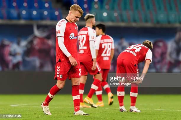 Philipp Lienhart of SC Freiburg, Vincenzo Grifo of SC Freiburg, Chang-hoon Kwon of SC Freiburg and Lino Tempelmann of SG Freiburg looks dejected...