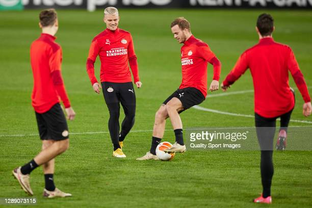 Philipp Max and Jorrit Hendrix of PSV Eindhoven in action during training session ahead of the UEFA Europa League Group E stage match between PSV...
