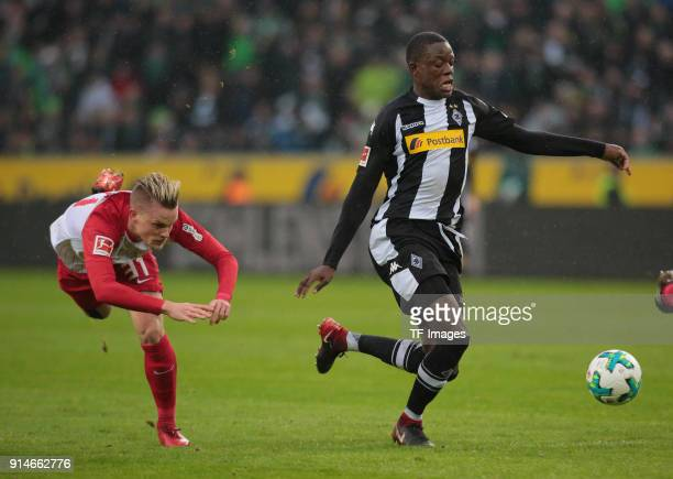 Philipp Max of Augsburg and Denis Zakaria of Moenchengladbach battle for the ball during the Bundesliga match between Borussia Moenchengladbach and...