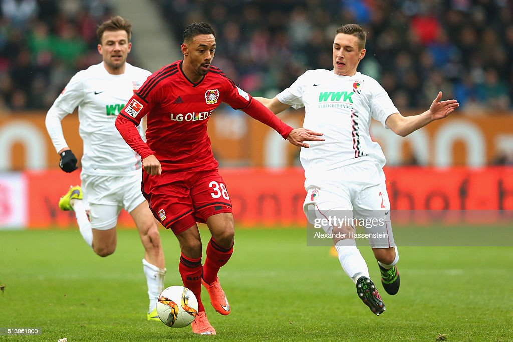 Philipp Max (L) of Augsburg and his team mate Dominik Kohr (R) battle for the ball with Karim Bellarabi of Leverkusen during the Bundesliga match between FC Augsburg and Bayer Leverkusen at WWK Arena on March 5, 2016 in Augsburg, Germany.