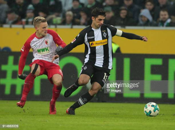 Philipp Max of Augsburg and Lars Stindl of Moenchengladbach battle for the ball during the Bundesliga match between Borussia Moenchengladbach and FC...