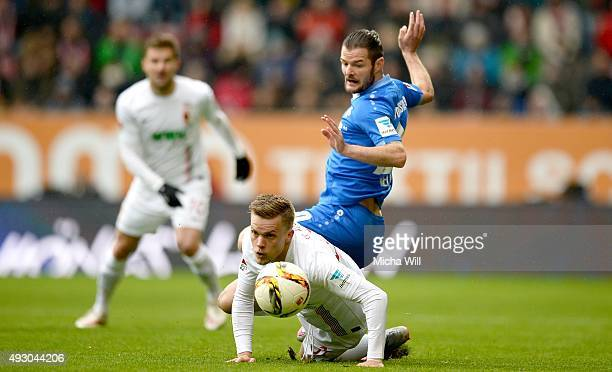 Philipp Max of Augsburg and Marcel Heller of Darmstadt tussle for the ball during the Bundesliga match between FC Augsburg and SV Darmstadt 98 at WWK...