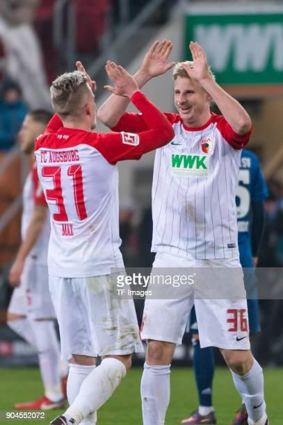 Philipp Max of Augsburg and Martin Hinteregger of Augsburg celebrate after winning the Bundesliga match between FC Augsburg and Hamburger SV at...