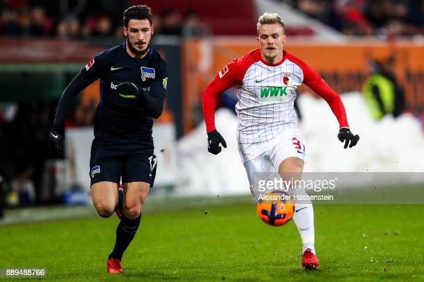 Philipp Max of Augsburg and Matthew Leckie of Hertha Berlin run for the ball during the Bundesliga match between FC Augsburg and Hertha BSC at...