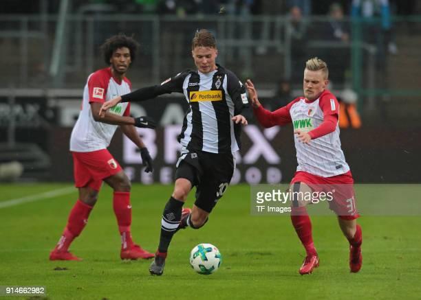 Philipp Max of Augsburg and Nico Elvedi of Moenchengladbach battle for the ball during the Bundesliga match between Borussia Moenchengladbach and FC...