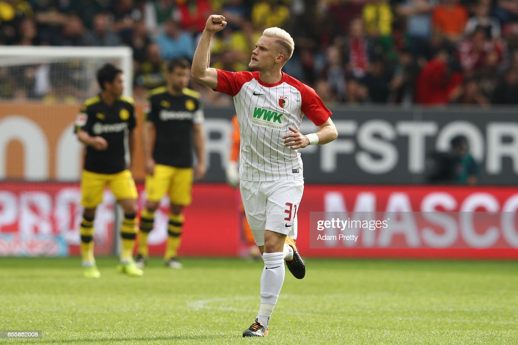 Philipp Max of Augsburg celebrates after Caiuby of Augsburg (not pictured) scored the first goal for Augsburg to make it 1:1 during the Bundesliga match between FC Augsburg and Borussia Dortmund at WWK-Arena on September 30, 2017 in Augsburg, Germany.