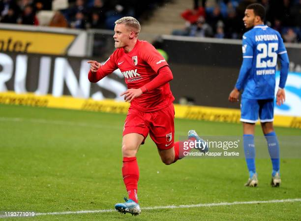 Philipp Max of Augsburg celebrates after he scores the opening goal during the Bundesliga match between TSG 1899 Hoffenheim and FC Augsburg at...