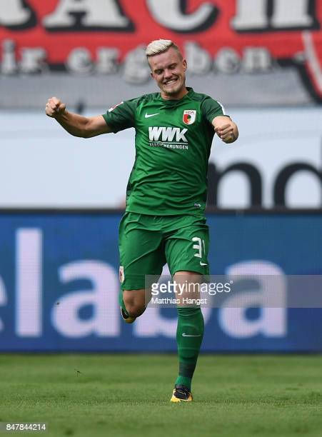 Philipp Max of Augsburg celebrates with his teammates after scoring his team's first goal during the Bundesliga match between Eintracht Frankfurt and...