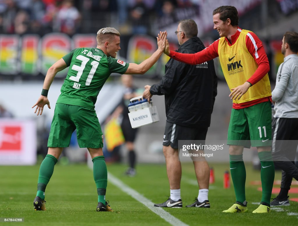 Philipp Max of Augsburg celebrates with his team-mates after scoring his team's first goal during the Bundesliga match between Eintracht Frankfurt and FC Augsburg at Commerzbank-Arena on September 16, 2017 in Frankfurt am Main, Germany.
