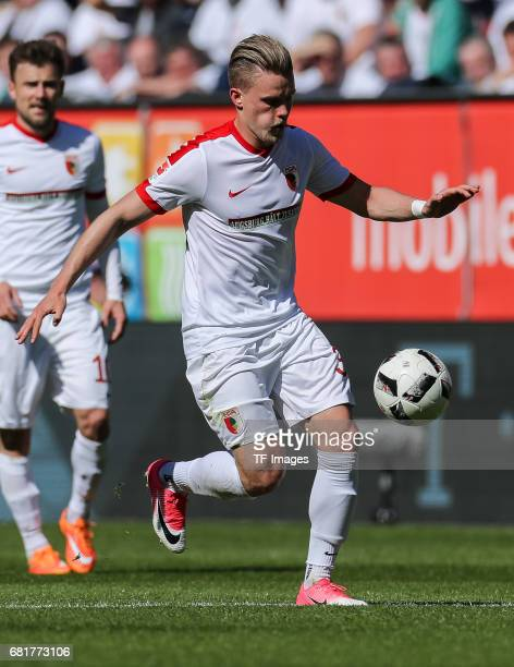 Philipp Max of Augsburg controls the ball during the Bundesliga match between FC Augsburg and Hamburger SV at WWK Arena on April 30 2017 in Augsburg...