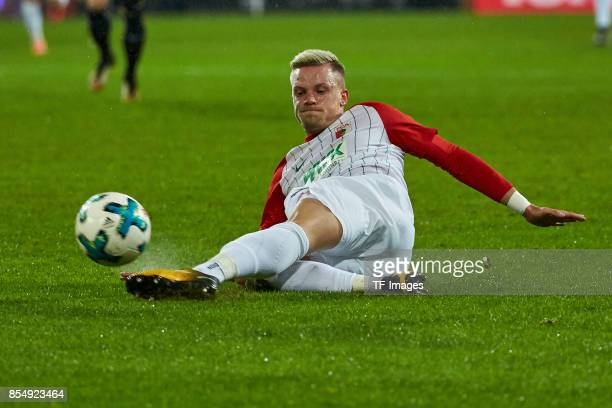 Philipp Max of Augsburg controls the ball during the Bundesliga match between FC Augsburg and RB Leipzig at WWKArena on September 19 2017 in Augsburg...
