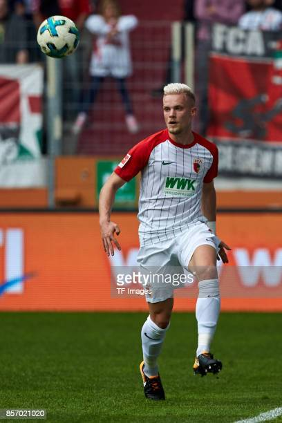 Philipp Max of Augsburg controls the ball during the Bundesliga match between FC Augsburg and Borussia Dortmund at WWKArena on September 30 2017 in...