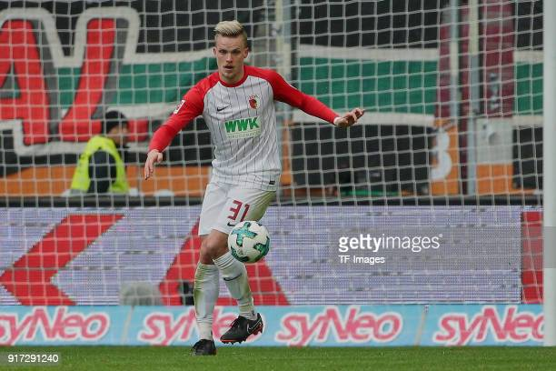 Philipp Max of Augsburg controls the ball during the Bundesliga match between FC Augsburg and Eintracht Frankfurt at WWKArena on February 4 2018 in...