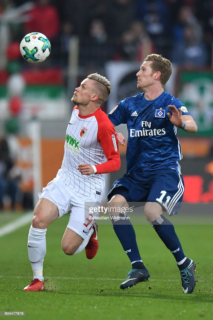 Philipp Max of Augsburg (l) fights for the ball with Andre Hahn of Hamburg during the Bundesliga match between FC Augsburg and Hamburger SV at WWK-Arena on January 13, 2018 in Augsburg, Germany.
