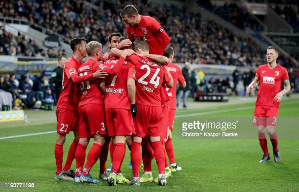 Philipp Max of Augsburg is congratulated after he scores the opening goal during the Bundesliga match between TSG 1899 Hoffenheim and FC Augsburg at...