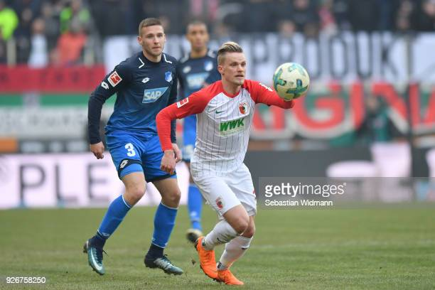 Philipp Max of Augsburg plays the ball during the Bundesliga match between FC Augsburg and TSG 1899 Hoffenheim at WWKArena on March 3 2018 in...