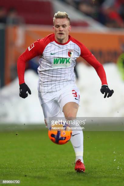 Philipp Max of Augsburg runs with the ball during the Bundesliga match between FC Augsburg and Hertha BSC at WWKArena on December 10 2017 in Augsburg...