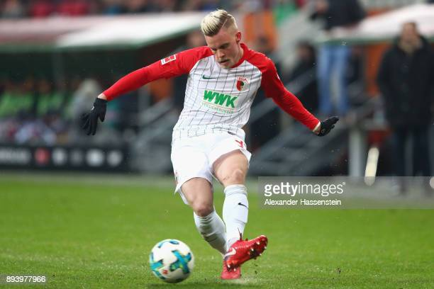 Philipp Max of Augsburg runs with the ball during the Bundesliga match between FC Augsburg and SportClub Freiburg at WWKArena on December 16 2017 in...