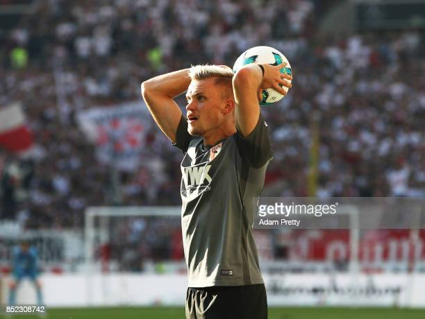 Philipp Max of Augsburg throws the ball in during the Bundesliga match between VfB Stuttgart and FC Augsburg at MercedesBenz Arena on September 23...
