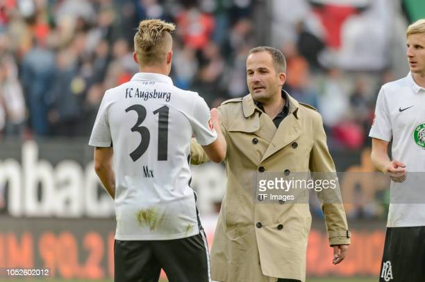 Philipp Max of FC Augsburg and head coach Manuel Baum of FC Augsburg gesture after the Bundesliga match between FC Augsburg and RB Leipzig at...