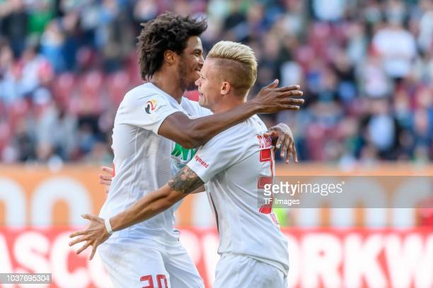 Philipp Max of FC Augsburg celebrates after scoring his team`s second goal with Francisco da Silva Caiuby of FC Augsburg during the Bundesliga match...