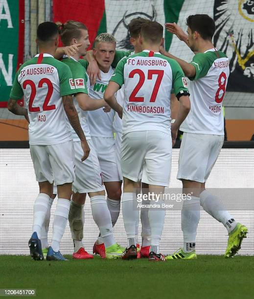 Philipp Max of FC Augsburg celebrates his first goal together with teammates during the Bundesliga match between FC Augsburg and Sport-Club Freiburg...