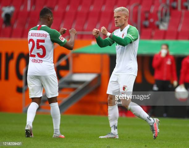 Philipp Max of FC Augsburg celebrates with Carlos Gruezo after scoring his team's first goal during the Bundesliga match between FC Augsburg and 1....