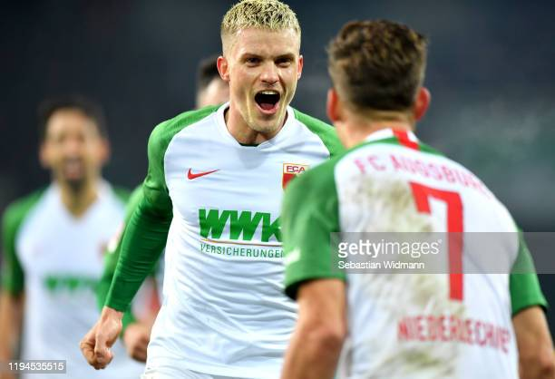 Philipp Max of FC Augsburg celebrates with Florian Niederlechner after scoring his team's first goal during the Bundesliga match between FC Augsburg...