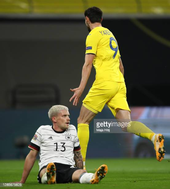 Philipp Max of Germany reacts as Roman Yaremchuk of Ukraine celebrates his team's first goal during the UEFA Nations League group stage match between...