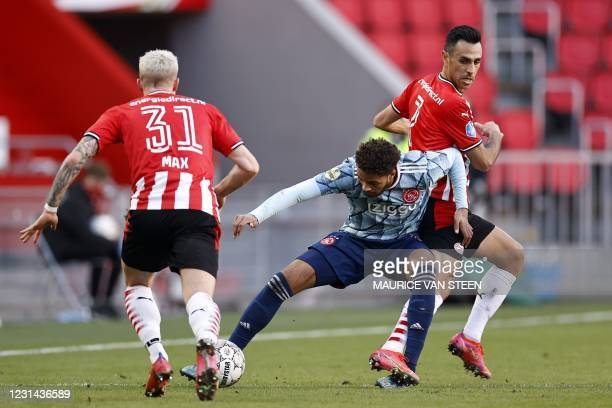 Philipp Max of PSV Eindhoven, Devyne Rensch of Ajax, Eran Zahavi of PSV Eindhoven fights for the ball during the Dutch Eredivisie match between PSV...