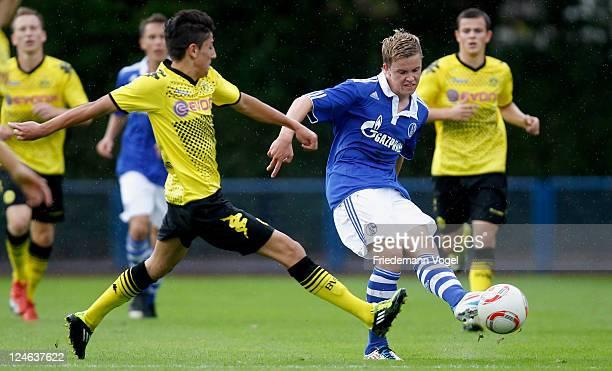 Philipp Max of Schalke and Kerem Demirbay of Dortmund battle for the ball during the A-Junioren match between FC Schalke 04 and Borussia Dortmund on...