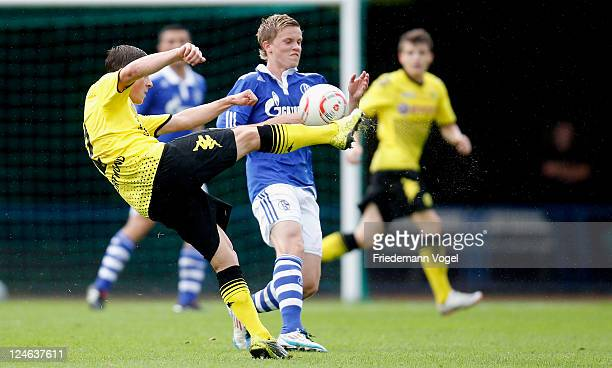 Philipp Max of Schalke and Noah Korczowski of Dortmund battle for the ball during the A-Junioren match between FC Schalke 04 and Borussia Dortmund on...