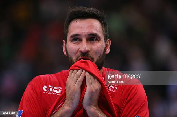Philipp Mueller of Melsungen looks dejected after the DHB Pokal handball semi final match between MT Melsungen and Fuechse Berlin at O2 World on...