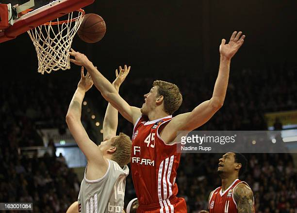 Philipp Neumann is challenged by Jan-Hendrik Jagla during the BBL-match between Bayern Muenchen v Brose Baskets at Audi-Dome on March 3, 2013 in...