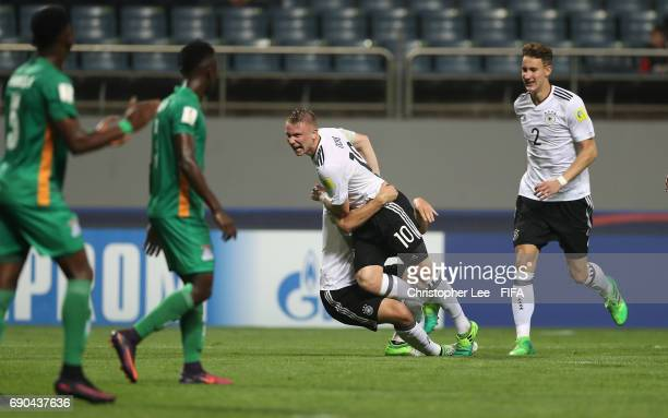 Philipp Ochs of Germany celebrates scoring their first goal with Benedikt Gimber of Germany during the FIFA U20 World Cup Korea Republic 2017 Round...
