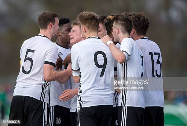 Philipp Ochs of Germany celebrates the first goal for his team with Benjamin Henrichs of Germany Frederic Ananou of Germany Maximilian Mittelstaedt...