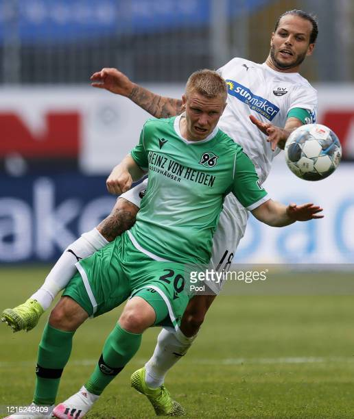 Philipp Ochs of Hannover in action against Dennis Diekmeier of Sandhausen during the Second Bundesliga match between SV Sandhausen and Hannover 96 at...