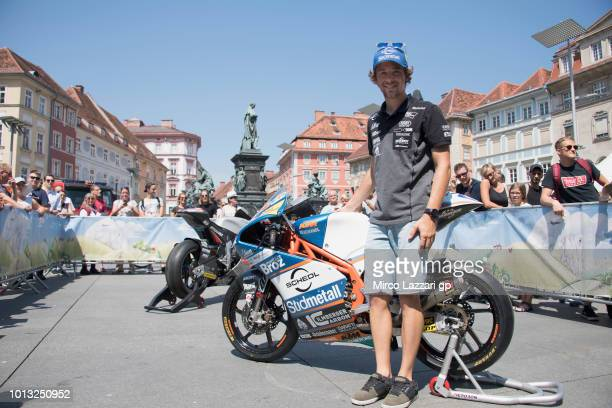 Philipp Oettl of Germany and Sudmetall Schedl GP Racing poses for fans near his bike during the preevent in Herrengasse in Graz during the MotoGp of...